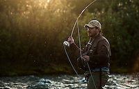 150620-JRE-7981E-0238 Cal Trout, a teacher and quail hunting guide from Mississippi, fishes an interior Alaska stream for Arctic Grayling.