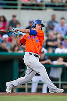 Midland RockHounds outfielder Jake Goebbert (14) follows through on his swing during the Texas League baseball game against the San Antonio Missions on July 13, 2013 at Nelson Wolff Municipal Stadium in San Antonio, Texas. The Missions defeated the Rock Hounds 5-4. (Andrew Woolley/Four Seam Images)