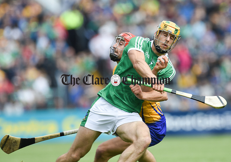 Peter Duggan of Clare in action against Dan Morrissey of Limerick during their Munster championship game in Ennis. Photograph by John Kelly.