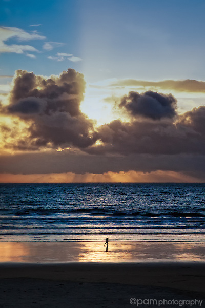 Couple walking on Pismo Beach at sunset