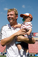 FC Dallas midfielder Bobby Rhine (19) and his son on the field folowing their win over the Chicago Fire.  Chicago Fire vs FC Dallas at Pizza Hut Park Frisco, Texas June-15-2008.  FC Dallas 1, Chicago 0.