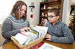 TORRINGTON, CT-122717JS04----Lori Pepler,  wife of  late Torrington Fire Department Deputy Chief, Chris Pepler, with their son Nathan, 10, look through a basket of condolences letters at their Torrington home on Thursday. Jim Shannon Republican-American
