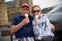 Aberystwyth Wales UK, Friday 06 May 2016<br /> UK Weather: A father and daughter (who has just returned to Wales on a two week break fro her job as an au pair in the USA) enjoy an ice cream together on  a bright, warm, but overcast day in Aberystwyth Wales.<br /> The Met Office have issued an amber warning for heavy rainstorms over the whole of Wales at times tomorrow (saturday) as the temperature climbs to the mid 20's centigrade
