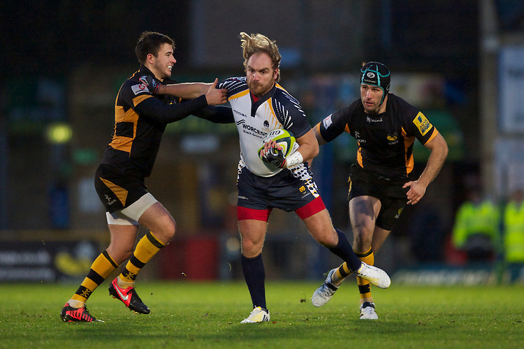 Andy Goode of Worcester Warriors is tackled by brothers Tommy Bell (left) and Chris Bell of London Wasps during the LV= Cup second round match between London Wasps and Worcester Warriors at Adams Park on Sunday 18th November 2012 (Photo by Rob Munro)