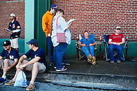 BOSTON, MASS. - SEPT. 28, 2014: People stand in line for game-day tickets at Fenway Park before the New York Yankees and Boston Red Sox play at Fenway Park. These people have been in line since about 6am for the 1:30pm game. Scott Corey (light blue, sleeping) and his son Ivan Corey (red shirt, sitting) drove from Dennysville, Maine, starting at about midnight the night before to stand in line. On the way, they saw 1 deer, 2 foxes, 1 raccoon, and 1 frog. Standing, Andrew McMahon (in yellow) and wife Stephanie McMahon (white shirt), drove from Rutland, Vermont, for the game. They arrived at 2am and napped in their car until getting in line at 6am. The game is last game of Derek Jeter's career. M. Scott Brauer for The New York Times