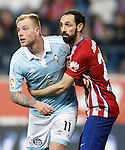 Atletico de Madrid's Juanfran Torres (r) and Celta de Vigo's John Guidetti during Spanish Kings Cup match. January 27,2016. (ALTERPHOTOS/Acero)