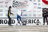 #10: Alex Palou, Chip Ganassi Racing Honda celebrates winning, #26: Colton Herta, Andretti Autosport Honda, #12: Will Power, Team Penske Chevrolet, champagne