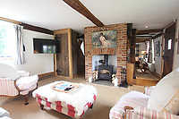 BNPS.co.uk (01202 558833)<br /> Pic: Cheffins/BNPS<br /> <br /> Pictured: The sitting room<br /> <br /> Crime history fans can live in the home of notorious highwayman Dick Turpin for £1,950 a month.<br /> <br /> The infamous criminal ran a butcher's shop from this pretty thatched cottage before he joined a deer thief gang in the 1730s.<br /> <br /> Turpin was born opposite this house at the Bluebell Inn and staged cockfights in a grass area opposite the house which is still known as Turpin's ring.<br /> <br /> Robert Palmer bought the Grade II Listed Dick Turpin's Cottage in Hempstead, Essex, in 2012 and spent eight years gutting and refurbishing the house to make it more suitable for modern living.
