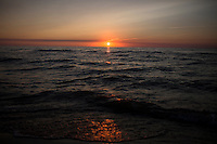 The sun sets over Lake Michigan on Saturday, May 21, 2016, in Lakeside, Michigan. (Photo by James Brosher)