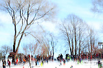 Children and their parents sled down a hill in Carl Schurz Park in Manhattan, New York, after a significant snowstorm blanketed the Mid-Atlantic States on January 24, 2016.