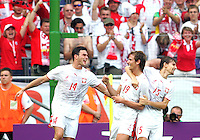 Bartosz Bosacki (19) of Poland celebrates scoring with teammates Michal Zewlakow (14) and Ebi Smolarek (15). Poland defeated Costa Rica 2-1 in their FIFA World Cup Group A match at FIFA World Cup Stadium, Hanover, Germany, June 20, 2006.