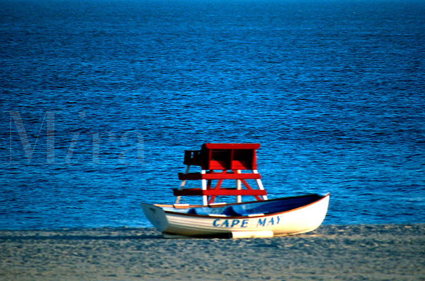 A lone lifeguard rescue boat sits on the beach in Cape May, New Jersey