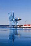 Container Craines at the Port of Tacoma.   Commencement Bay's history of industry and shipping has led it to designation as a Superfund Cleanup Site and one of the most polluted waterways in the nation.  Commencement Bay Nearshore/Tideflats (CB/NT) Superfund Site.  Image represented exclusively by Spaces Images, www.spacesimages.com