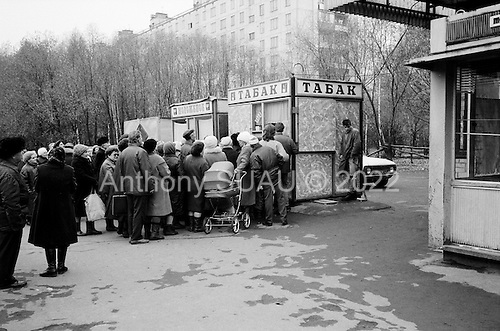 """Moscow, Russia<br /> October 22, 1992<br /> <br /> People purchase cigarettes, for resale, at a kiosk near Kievski train station.<br /> <br /> In December 1991, food shortages in central Russia had prompted food rationing in the Moscow area for the first time since World War II. Amid steady collapse, Soviet President Gorbachev and his government continued to oppose rapid market reforms like Yavlinsky's """"500 Days"""" program. To break Gorbachev's opposition, Yeltsin decided to disband the USSR in accordance with the Treaty of the Union of 1922 and thereby remove Gorbachev and the Soviet government from power. The step was also enthusiastically supported by the governments of Ukraine and Belarus, which were parties of the Treaty of 1922 along with Russia.<br /> <br /> On December 21, 1991, representatives of all member republics except Georgia signed the Alma-Ata Protocol, in which they confirmed the dissolution of the Union. That same day, all former-Soviet republics agreed to join the CIS, with the exception of the three Baltic States."""