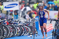 26 AUG 2012 - STOCKHOLM, SWE - Non Stanford (GBR) of Great Britain runs through transition at the end of her bike leg during the  2012 ITU Mixed Relay Triathlon World Championships in Gamla Stan, Stockholm, Sweden (PHOTO (C) 2012 NIGEL FARROW)