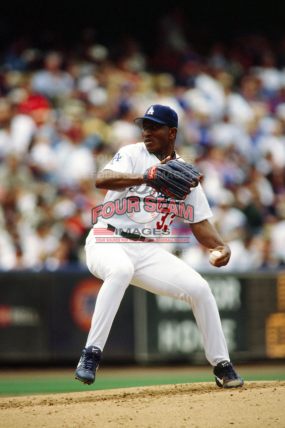 Carlos Perez of the Los Angeles Dodgers during a game at Dodger Stadium circa 1999 in Los Angeles, California. (Larry Goren/Four Seam Images)