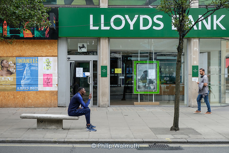 Boarded up shop and closed branch of Lloyds Bank.  Midweek shoppers in Oxford Street London following the easing of Covid-19 lockdown measures.