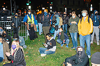 People watch election results as demonstrators gather in McPherson Square near the White House on the night of Election Day in Washington, D.C., on Tue., Nov. 3, 2020. Election results remained uncertain late into the night and demonstrators were peaceful.