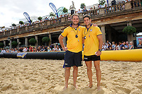 20130810 Copyright onEdition 2013 ©<br /> Free for editorial use, please credit: onEdition<br /> <br /> The inaugural Doom Bar London Beach Rugby continues its exciting and action-packed debut in Covent Garden today. <br /> <br /> 120 tonnes of sand were shipped in to create a temporary pitch in the centre of London. London Rugby Clubs are playing today and blue chip London city firms played yesterday. <br /> <br /> Doom Bar London Beach Rugby is a new and exciting 5-a-side touch rugby tournament that is being hosted in 2013 at London's premier location, Covent Garden, on an imported sand pitch. London Beach Rugby will be high end, but fun and will be an excellent networking and entertaining opportunity for all entrants, sponsors, advertisers and our chosen charity, Restart.<br /> <br /> For more information please contact: Myles Waud myles@londonbeachrugby.com or call 07946 357706<br /> <br /> For further test images please visit: www.w-w-i.com/london_beach_rugby_2013/<br /> If you require a higher resolution image or you have any other onEdition photographic enquiries, please contact onEdition on 0845 900 2 900 or email info@onEdition.com<br /> <br /> This image is copyright onEdition 2013 ©.<br /> <br /> This image has been supplied by onEdition and must be credited onEdition. The author is asserting his full Moral rights in relation to the publication of this image. Rights for onward transmission of any image or file is not granted or implied. Changing or deleting Copyright information is illegal as specified in the Copyright, Design and Patents Act 1988. If you are in any way unsure of your right to publish this image please contact onEdition on 0845 900 2 900 or email info@onEdition.com