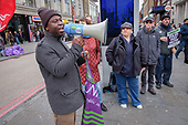 Striking Camden civil enforcement officers (traffic wardens) employed by private contractor NSL march through Camden Town to demand fair pay (£11.15 an hour) during five days of industrial action.  Liz Wheatley, Camden Unison Branch Secretary (listening in background).