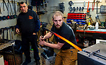 "WOLCOTT, CT-011421JS03- Aric Fontaine, owner of Fontaine Forge in Bristol, works inside the shop at Faith and Forge in Wolcott on Thursday as Brian S. Evelich, owner and blacksmith at the shop looks on. Fontaine won $10,000 and bragging rights as the champion of Wednesday night's episode of ""Forged in Fire, a reality TV show on the History Channel. <br /> Jim Shannon Republican-American"