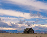 Clearing storm over a barn and windmill on a ranch near Raton, NM