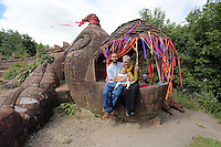 Pictured: Artist Gwen Heeney with her son Valentine Kuhl and grandson Aurora Jorge-Kuhl, by her creation, the mythical beast Saturday 13 August 2016<br />