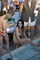 MIAMI BEACH, FL - DECEMBER 30: EXCLUSIVE COVERAGE Actress Lindsay Lohan sitting poolside with friends and family at the Delano Hotel .  On December 30, 2005 in Miami Beach, Florida.<br /> <br /> People; Lindsay Lohan