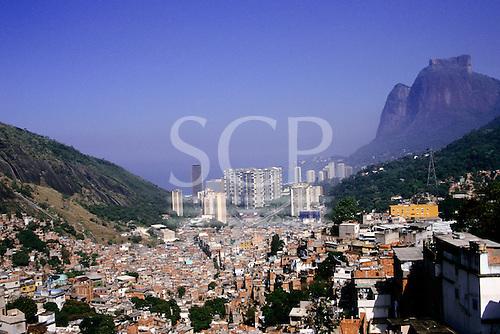 Rio de Janeiro, Brazil. Aerial view of favela Rocinha with the wealthy beach resort of Sao Conrado behind; rich-poor contrast.