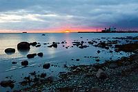 Estonia, Tallinn, Dinner on sunset coastline at Noa restaurant.