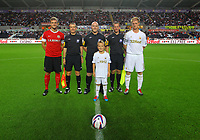 Pictured: Alan Tate (R) with Barnsley captain (L) and match officials. Tuesday 28 August 2012<br /> Re: Capital One Cup game, Swansea City FC v Barnsley at the Liberty Stadium, south Wales.