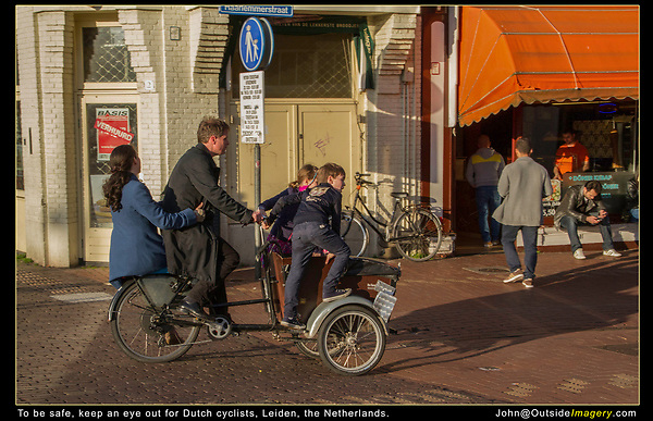 Netherlands, Leiden.  <br /> No one mentions that pedestrians need to be very careful in the Netherlands. Picture yourself standing in front of this lovely Dutch family rushing home for dinner. Especially, if you're paying more attention to your camera or phone. Then there are the Vespas and assorted scooters to watch out for.