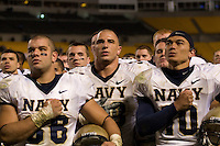 10 October 2007: Navy players Eric Kettani (36), Michael Walsh (center) and Kaipo-Noa Kaheaku-Enhada (10)..The Navy Midshipmen beat the Pitt Panthers 48-45 in double overtime on October 10, 2007 at Heinz Field, Pittsburgh, Pennsylvania.