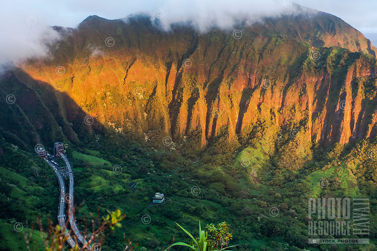 """An aerial view of the Ko'olau mountain range and H-3 Freeway in Haiku valley at dawn from the Haiku Stairs (""""Stairway to Heaven"""") hiking trail in Kaneohe, O'ahu"""