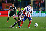 Atletico de Madrid´s Jesus Gamez and Bayer 04 Leverkusen´s Calhanoglu during the UEFA Champions League round of 16 second leg match between Atletico de Madrid and Bayer 04 Leverkusen at Vicente Calderon stadium in Madrid, Spain. March 17, 2015. (ALTERPHOTOS/Victor Blanco)