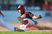 Batavia Muckdogs outfielder Stone Garrett (11) slides into third on a triple during the first game of a doubleheader against the Mahoning Valley Scrappers on July 2, 2015 at Dwyer Stadium in Batavia, New York.  Batavia defeated Mahoning Valley 4-1.  (Mike Janes/Four Seam Images)