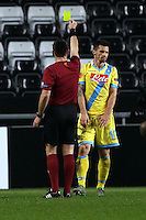 Swansea, UK. Thursday 20 February 2014<br /> Pictured: Christian Maggio (R) of Napoli sees a yellow card by match referee Ivan Bebek (L)<br /> Re: UEFA Europa League, Swansea City FC v SSC Napoli at the Liberty Stadium, south Wales, UK