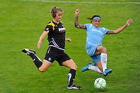 Allison Falk (3) of the Los Angeles Sol is tackled by Natasha Kai (6) of Sky Blue FC during a Women's Professional Soccer match at Yurcak Field in Piscataway, NJ, on June 13, 2009.