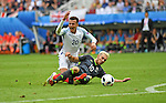 Aaron Ramsey of Wales is tackled by Dele Alli of England in the second half at the Stade Bollaert-Delelis in Lens, France this afternoon during their Euro 2016 Group B fixture.