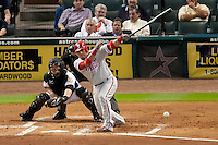 Philadelphia Phillies catcher Carlos Ruiz #51 swings during the Major League Baseball game against the Houston Astros at Minute Maid Park in Houston, Texas on September 13, 2011. Houston defeated Philadelphia 5-2.  (Andrew Woolley/Four Seam Images)