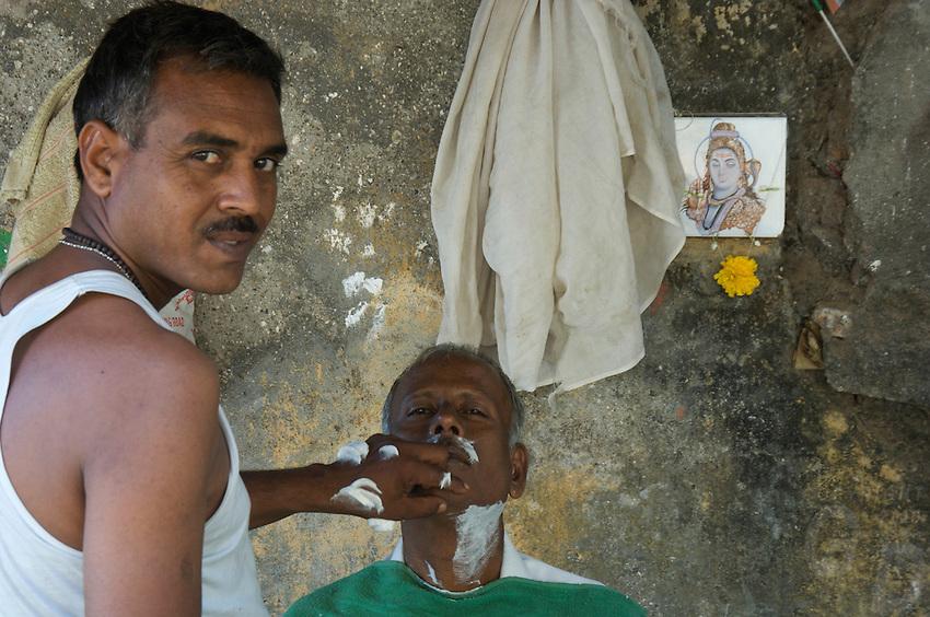 A outdoor Mumbai barbershop, central Mumbai,India