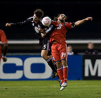 Dejan Jakovic (5) of D.C. United goes up for a header against Dwayne de Rosario (14) of Toronto FC during the game at RFK Stadium in Washington, DC.  Toronto defeated D.C. United, 3-2.