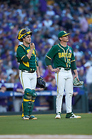 Baylor Bears catcher Andy Thomas (25) and starting pitcher Evan Godwin (27) watch a reply on the video board during the game against the LSU Tigers in game five of the 2020 Shriners Hospitals for Children College Classic at Minute Maid Park on February 28, 2020 in Houston, Texas. The Bears defeated the Tigers 6-4. (Brian Westerholt/Four Seam Images)