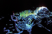 Man sitting insde Kazumura cave, the worlds longest lava tube, Puna district
