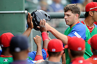 Designated hitter Danny Bethea (26) of the Greenville Drive is congratulated after scoring in a game against the Augusta GreenJackets on Sunday, April 12, 2015, at Fluor Field at the West End in Greenville, South Carolina. Augusta won, 2-1. (Tom Priddy/Four Seam Images)