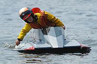 Tracy Trollian rows her boat ashore.  (hydro)