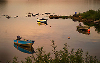 Boats with reflection in evening light with reflections in Clarendon, Newfoundland, Canada