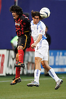 MetroStars'  Sergio Galvan Rey goes up for a header against the Wizard's Nick Garcia. The Kansas City Wizards were defeated by  the NY/NJ MetroStars to a 1 to 0 at Giant's Stadium, East Rutherford, NJ, on May 30, 2004.