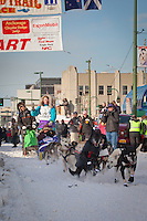 Musher Angie Taggart and Iditarider Marthalee Beckington.leave the 2011 Iditarod ceremonial start line in downtown Anchorage, Alaska