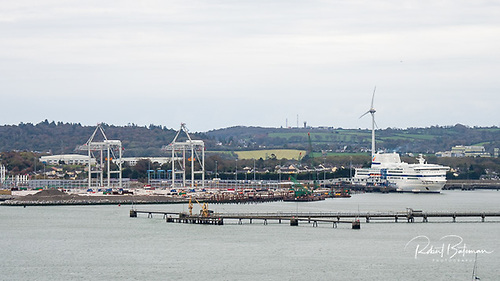 Progress continues on the development of the new Port of Cork terminal with the two new Liebherr post-Panamax size ship-to-shore (STS) container gantry cranes (centre) and Pont Aven ferry in berth (right)